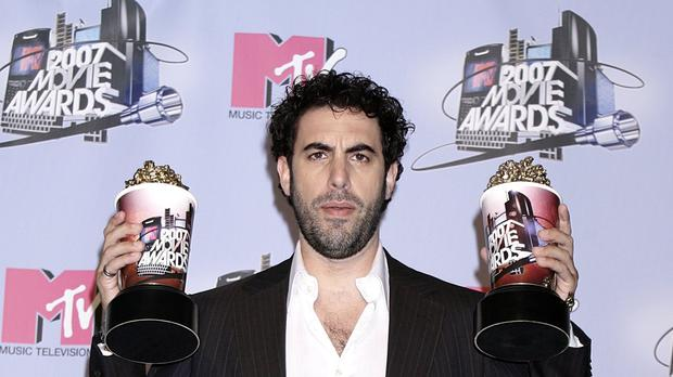 Sacha Baron Cohen admits he has had to tone down his act since becoming a father