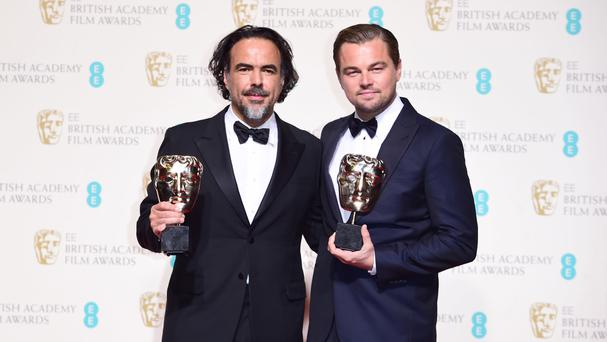 The Revenant's director Alejandro Gonzalez Inarritu and its star Leonardo DiCaprio with their Baftas for Best Director and Best Actor.