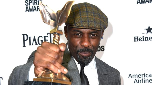 Idris Elba with his best supporting male gong for Beasts Of No Nation (Invision/AP)