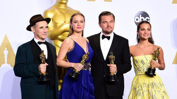 Mark Rylance, Brie Larson, Leonardo DiCaprio and Alicia Vikander with their Oscars (AP)