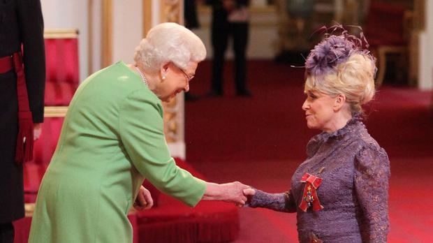 Television star Barbara Windsor is made a Dame Commander of the order of the British Empire by the Queen