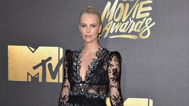 Charlize Theron arrives at the MTV Movie Awards (AP)