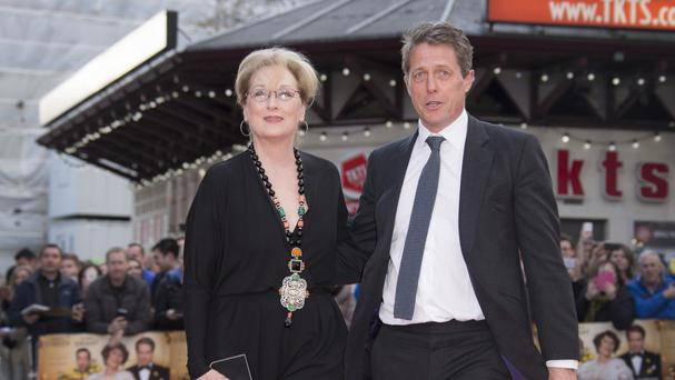 Meryl Streep and Hugh Grant greet one another upon arrival at the premiere of Florence Foster Jenkins in London (AP)
