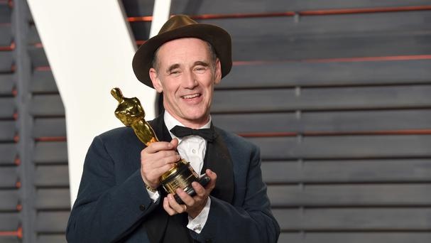 Mark Rylance arrives at the Vanity Fair Oscar Party in Los Angeles with his Academy Award