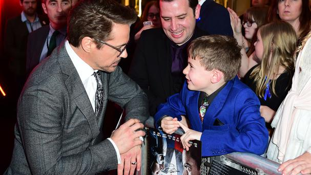 Robert Downey Jr meets seven-year-old Ethan Miller at the Captain America: Civil War European premiere in London