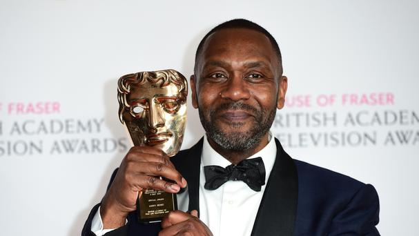 Sir Lenny Henry with the special award during the House of Fraser Bafta TV Awards 2016