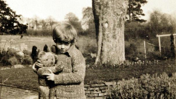 The real Christopher Robin with the original Winnie-the-Pooh
