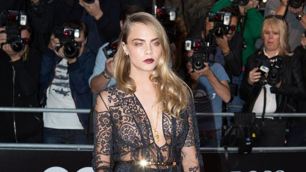 Cara Delevingne returns to her home town for the premiere