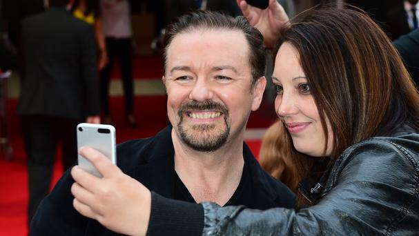 Ricky Gervais meets fans at the premiere in Leicester Square