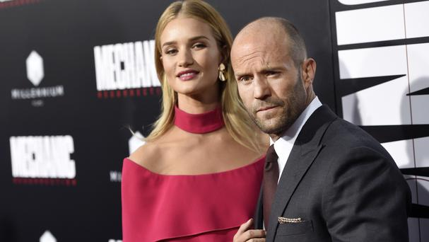 Jason Statham and fiancee Rosie Huntington-Whiteley at the premiere of Mechanic: Resurrection (Invision/AP)