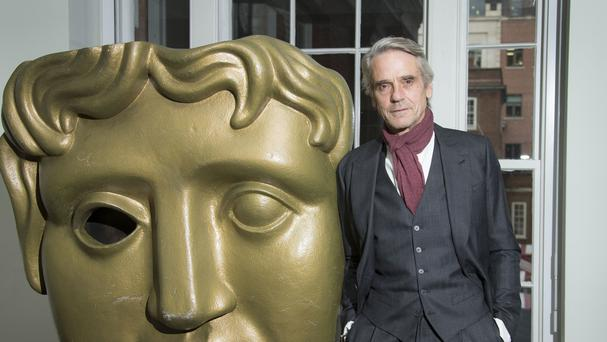 Actor Jeremy Irons poses for photographers during a BAFTA: A Life In Pictures photo call at BAFTA headquarters.