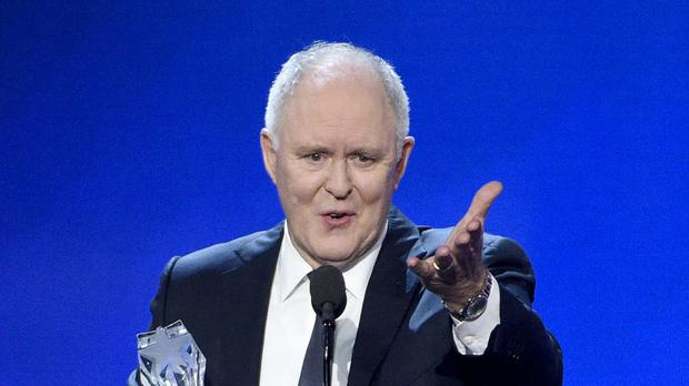 John Lithgow accepts the award for best supporting actor in a drama series for The Crown (Chris Pizzello/Invision/AP)