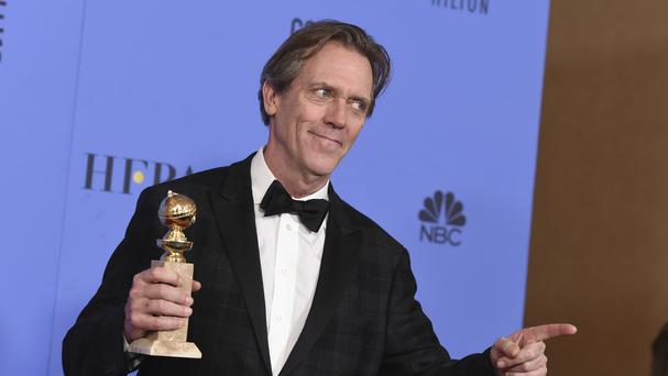 Hugh Laurie poses in the press room with his award for The Night Manager (Photo by Jordan Strauss/Invision/AP)