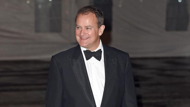 Hugh Bonneville arrives at a reception and dinner for supporters of the British Asian Trust