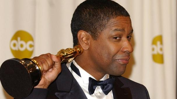 Denzel Washington pictured with the Oscar he won for Training Day