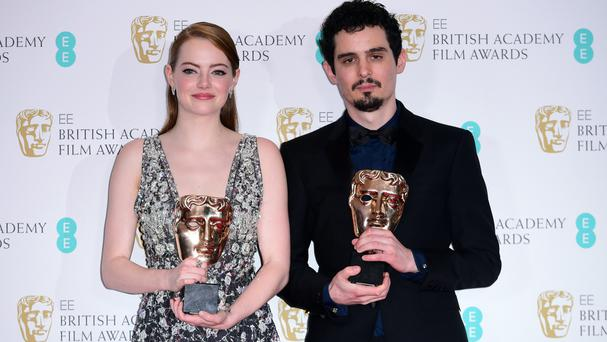 Emma Stone with the award for Leading Actress in the film La La Land alongside director Damien Chazelle