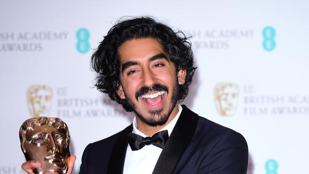 Dev Patel with his award for best Supporting Actor for the film Lion