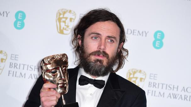 Casey Affleck with the award for Leading Actor for the film Manchester By The Sea