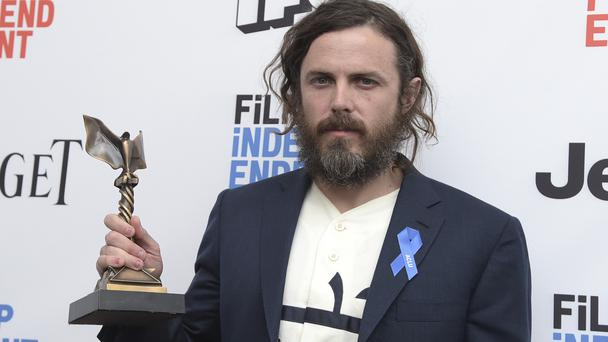 Casey Affleck with his best actor award for Manchester By The Sea (Invision/AP)