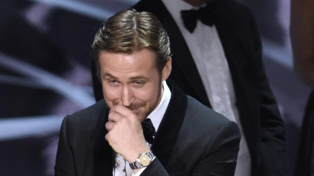 Ryan Gosling reacts as the true winner of best picture is announced at the Oscars (Chris Pizzello/Invision/AP)