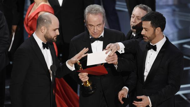 Warren Beatty, centre, after the error was revealed (Chris Pizzello/Invision/AP)