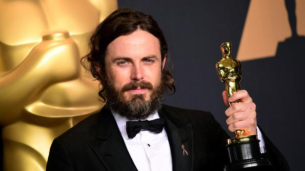 Casey Affleck with the award for actor in a leading role for Manchester By The Sea