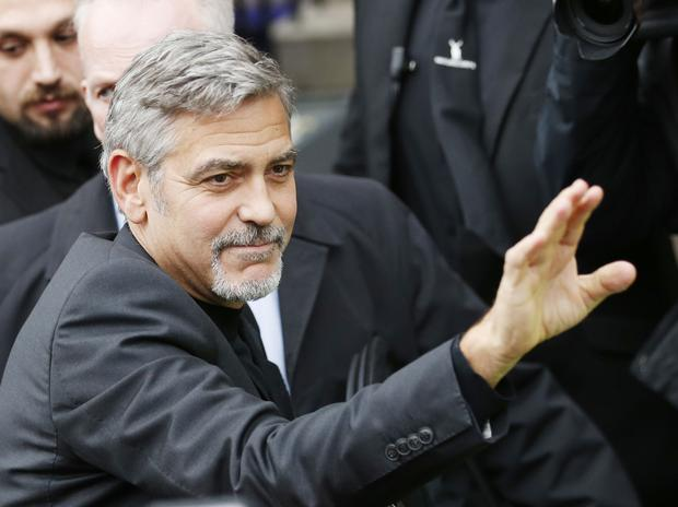 George Clooney outside the Tigerlily restaurant in Edinburgh, where he had lunch with 32-year-old wedding planner Heather McGowan, who won a competition to meet him.