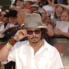 Johnny Depp arrives for the European Premiere of Pirates of the Caribbean: Dead Man's Chest, at the Odeon Cinema in Leicester Square, central London.