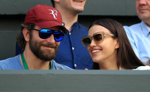 Bradley Cooper and Irina Shayk watches the action on centre court between Roger Federer and Marin Cilic on day nine of the Wimbledon Championships at the All England Lawn Tennis and Croquet Club, Wimbledon.