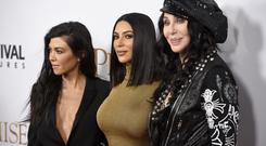 Kourtney Kardashian, from left, Kim Kardashian West and Cher arrive at the U.S. premiere of