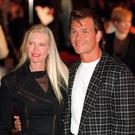 Patrick Swayze arrives with his wife Lisa, for the launch of the Planet Hollywood restaurant in London's West End. * 19/03/2003: The ultimate male screen sex symbol would have the smile of Tom Cruise with a 66% vote and the eyes of Robert Redford according to 43%. George Clooney's salt and pepper thatch was judged the best hairdo by 32% of those polled.53% opted for the body of Brad Pitt with 25% requesting Patrick Swayze's bottom. A number of older stars completed their ultimate male, with Jack Nicholson's sex appeal pulling in a 63% vote. And, according to 28%, Woody Allen's humour would complete the ultimate male screen idol. 14/9/04: Coming-of-age movie Dirty Dancing starring Patrick Swayze and Jennifer Grey has come top of a poll to find the nation's favourite film. The tale of sexual awakening was voted ahead of classics like The Godfather and epics like The Lord Of The Rings. ... Swayze & wife/Planet Hollywood ... 17-05-1993 ... LONDON ... UK ... Photo credit should read: Rebecca Naden/PA Archive. Unique Reference No. 1198888 ...