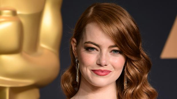 Emma Stone said men have had to voluntarily take cuts so they get the same pay (Ian West/PA)