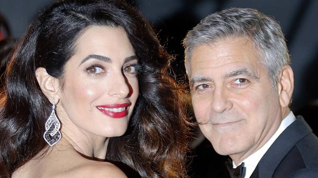 George Clooney threatened the French magazine with prosecution (Francois Mori/AP)