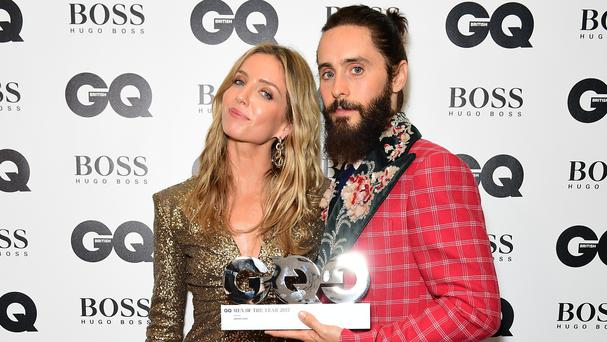 Jared Leto with the Best Actor award poses with Annabelle Wallis during the GQ Men of the Year Awards