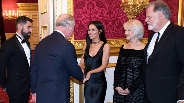 The Prince of Wales meets Adrien Koskas of L'Oreal, left, Cheryl, centre, Dame Helen Mirren and her husband Taylor Hackford (John Phillips/PA)