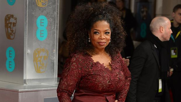 Oprah Winfrey said she is joining forces with George and Amal Clooney (Dominic Lipinski/PA)