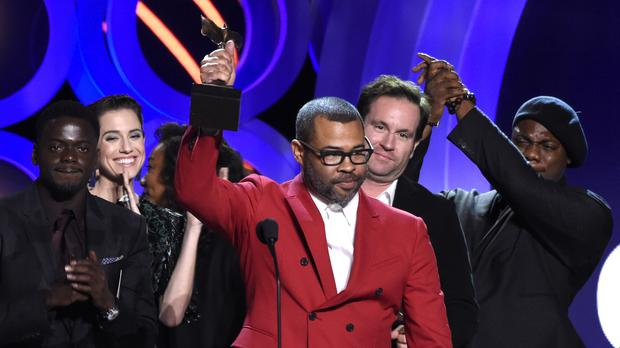 Jordan Peele accepting best feature for Get Out