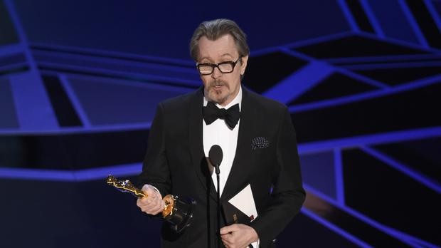 Gary Oldman accepts the award for best performance by an actor in a leading role (Chris Pizzello/Invision/AP)