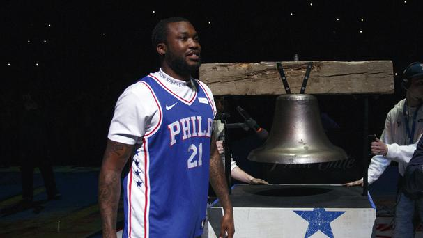 Rapper Meek Mill rings a Liberty Bell replica before the playoff game between the Miami Heat and the Philadelphia 76ers (Chris Szagola/AP)