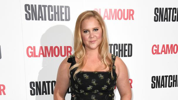 Amy Schumer posted a photograph of herself in a hospital bed (Doug Peters/PA)