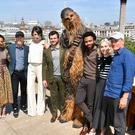 The cast and crew of Solo: A Star Wars Story (left to right) Thandie Newton, Ron Howard, Phoebe Waller-Bridge, Alden Ehrenreich, Chewbacca, Donald Glover, Emilia Clarke and Woody Harrelson (Matt Crossick/ PA)