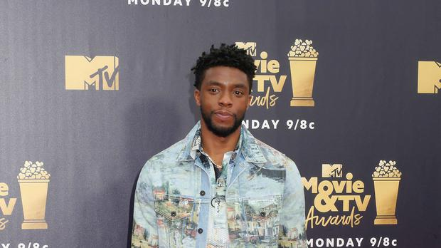 Chadwick Boseman handed over his Best hero award (Francis Specker/PA)