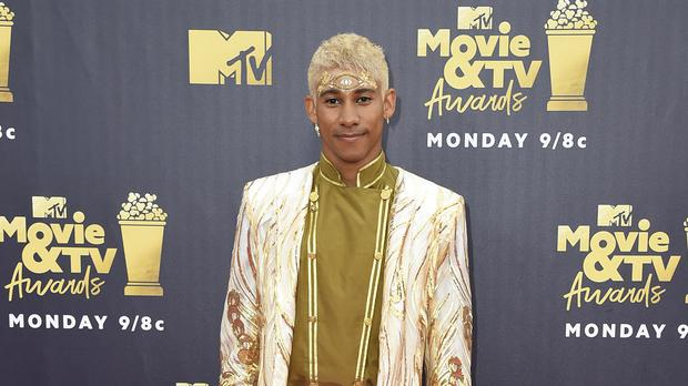 Keiynan Lonsdale accepted the prize for Best Kiss at the MTV Movie And TV Awards. (Jordan Strauss/Invision/AP)