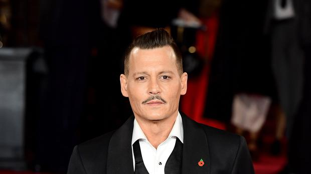 Johnny Depp has settled a lawsuit with his former managers a month before they were due in court (Ian West/PA)