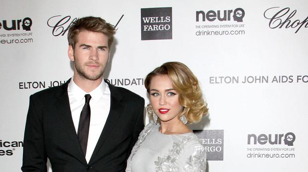 Liam Hemsworth and Miley Cyrus can be seen in a video together (Tony Di Maio/PA)