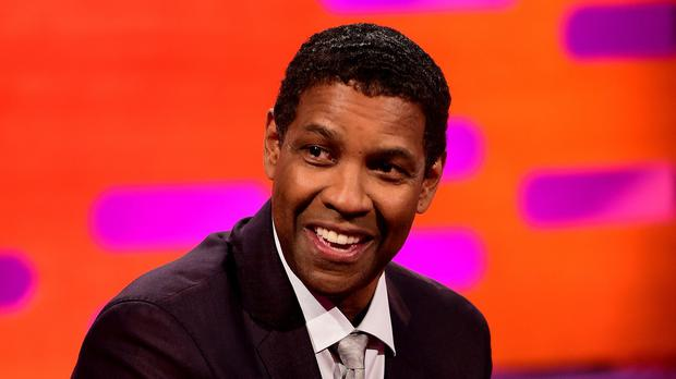 Denzel Washington has spoken about his pride in his son (Ian West/PA)