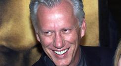 """Actor James Woods with Dawn Denoon arrives for the premiere of his new movie """"John Q"""" in Hollywood, California."""