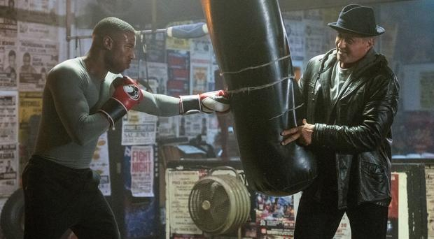 Warner Bros handout photo of Michael B Jordan as Adonis Creed and Sylvester Stallone as Rocky Balboa (Barry Wetcher/Warner Bros)