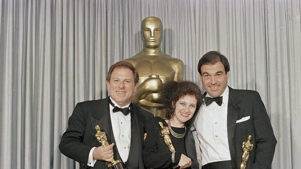 Claire Simpson, Arnold Kopelson, left, and Oliver Stone, after receiving their Oscars (Lennox McLendon/AP)