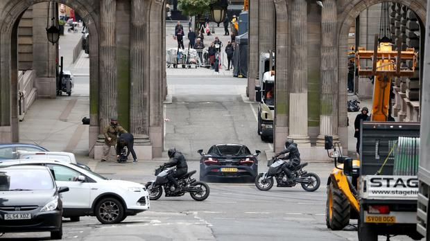 Filming for a car chase scene involving a McLaren sports car and motorbikes takes place in Glasgow city centre (Jane Barlow/PA)